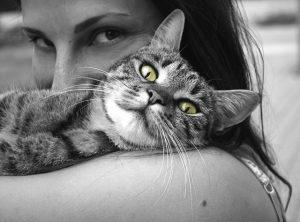 woman cuddling cat - pet cremation Gold Coast & Brisbane